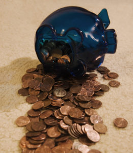 Piggy bank, pennies spilling out